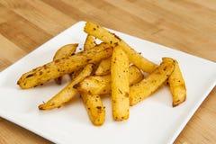 Rutabaga Fries. White plate of rutabaga fries on wood Stock Photos