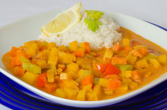 Rutabaga (swede) curry with coconut rice Stock Images