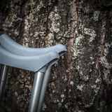 Сrutches near Birch trunk Royalty Free Stock Images