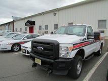 Rutgers vehicles on parking lot. Stock Photos