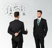 Ruthless business concept. Ruthless businessman handshake with hiding a weapon and weapon symbols around his head Royalty Free Stock Images