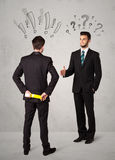 Ruthless business handshake Stock Images