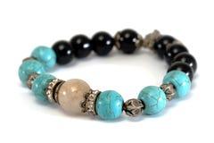 Rutile Quartz, Turquoise, Black Spinel Lucky stone bracelet with withe isolated background Royalty Free Stock Photo