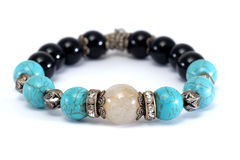 Rutile Quartz, Turquoise, Black Spinel Lucky stone bracelet with withe isolated background Royalty Free Stock Photos