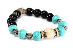 Rutile Quartz, Turquoise, Black Spinel Lucky stone bracelet with withe isolated background Royalty Free Stock Image