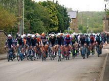 2019 Rutland-Melton Cicle Classic: The Peloton pass through the village of Wymondham. The Rutland-Melton Cicle Classic is a professional one day cycling race UCI royalty free stock photos