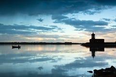 Rutland Water. Normanton church on Rutland Water will lone fisherman royalty free stock photography