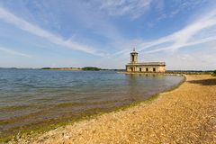 Rutland Water and Normanton Church, England, UK. View across Rutland Water to Normanton Church in England, UK - copy space provided stock photography