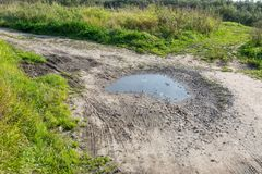 Ruts in the roads filled with water stock photo