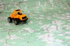 Toytraktor på kartlägga Royaltyfria Bilder