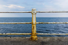 Ruty fence by the Black sea. Ruty fence by the sea Royalty Free Stock Images
