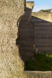 Ruwe concrete textuur van beschadigde muren Stock Afbeelding