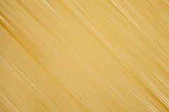 Ruwe ongekookte Italiaanse Spaghettii-achtergrond stock foto's