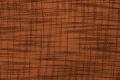 Ruwe oranje stof met een patroon royalty-vrije stock foto