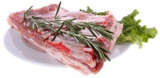 Ruwe ribben met rozemarijn Stock Afbeelding