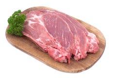 Ruwe varkensvleesschnitzel met peterselie Royalty-vrije Stock Foto