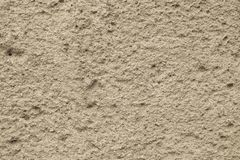 Ruwe zand-gekleurde muur als achtergrond stock afbeelding