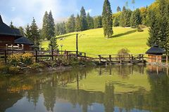 Ruzomberok - Cutkovska Valley: Enchanting the entrance to Cutkovska valley. Tourist center, original traditions, relaxation place. And small pond. Beautiful royalty free stock photography