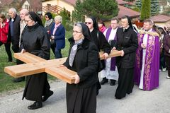 Nuns with cross at calvary. RUZOMBEROK, SLOVAKIA - APRIL 14: Nuns with cross at calvary. The Way of the cross during easter on April 14, 2019 in Ruzomberok stock image