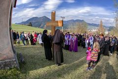Nuns with cross at calvary. RUZOMBEROK, SLOVAKIA - APRIL 14: Nuns with cross at calvary. The Way of the cross during easter on April 14, 2019 in Ruzomberok royalty free stock photos