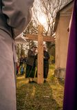 Nuns with cross at calvary. RUZOMBEROK, SLOVAKIA - APRIL 14: Nuns with cross at calvary. The Way of the cross during easter on April 14, 2019 in Ruzomberok stock images