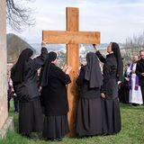 Nuns with cross at calvary. RUZOMBEROK, SLOVAKIA - APRIL 14: Nuns with cross at calvary. The Way of the cross during easter on April 14, 2019 in Ruzomberok royalty free stock photography