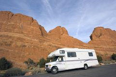 RV against red rock formation stock photos