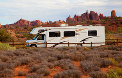 RV against red rock formation stock images