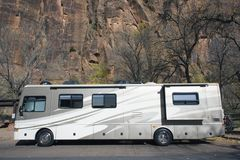 RV against rock formation royalty free stock image