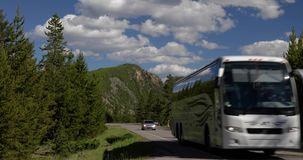 RV along a yellowstone national park 4k 24fps. RV along a yellowstone national park stock footage