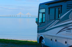 RV at beach with Tampa Bay Sunshine Skyway Bridge. RV recreational vehicle is parked at the beach overlooking Tampa Bay in Florida with the Sunshine Skyway Royalty Free Stock Photography