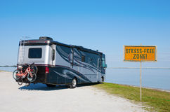 RV at beautiful beach with STRESS FREE ZONE! sign royalty free stock photography