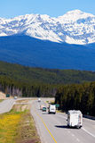 RV and buses on the road in Banff National Park Royalty Free Stock Photography