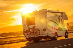 RV Camper Boondocking. On the Public Parking. Recreational Vehicle Traveling Royalty Free Stock Image