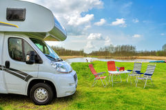 RV (camper) in camping, family vacation travel. Holiday trip in motorhome Stock Images