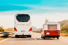 RV Camper Car and Bus on Road in Switzerland. RV Camper Car and Bus on Road. Caravan and motorhome in trip in Switzerland stock images