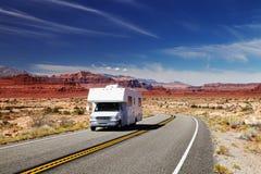 RV Camper on highway Stock Images