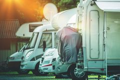 RV Camper Storage Place. Stored Recreational Vehicles on the Storage Parking Lot Royalty Free Stock Image