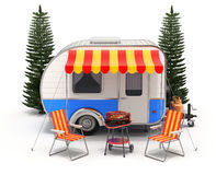 RV camper trailer with camping equipment Stock Photos