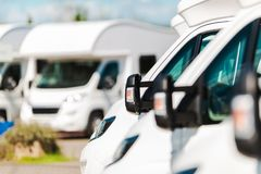RV Campers For Sale. In the RV Dealership. Brand New Motorcoaches. Travel and Tourism Industry stock photos