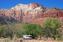 RV Campground. A motorhome camped at the foot of majestic mountains Stock Photos