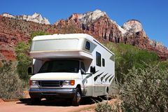 RV Camping. An RV sets up camp in the mountains of red rock country
