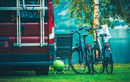 RV Camping and Biking. RV Camper Camping and Biking. Motorcoach and Two Bikes on the Campsite royalty free stock photography