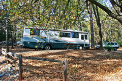 RV Camping in the Forest royalty free stock photography