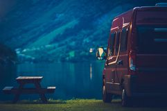RV Camping at Night. Small Camper Van Overnight Camping Royalty Free Stock Photography
