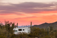 RV camping on Sonoran desert campground. Small motorhome RV parked on campsite in Sonoran Desert beside Saguaro Cacti royalty free stock image