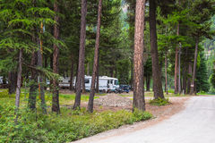 RV Camping in Wooded Campground Royalty Free Stock Images