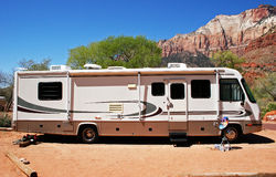 RV Campsite. A motorhome sets up camp in red rock country Royalty Free Stock Photos