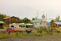 An rv and car parked at a rustic rv resort in atlin, canada. A motor-home enjoying the quiet nature at a camp-ground in northern bc Stock Photos