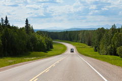 RV driving Alcan south Fort Nelson BC Canada Royalty Free Stock Photos
